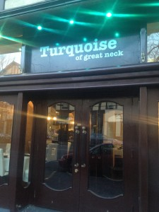 front of turquoise restaurant